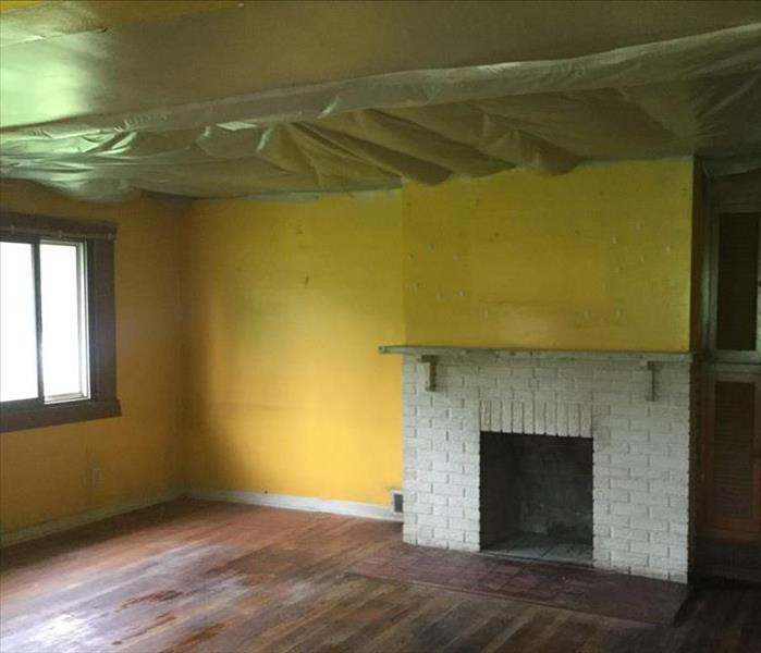 yellow living room with tarped ceiling