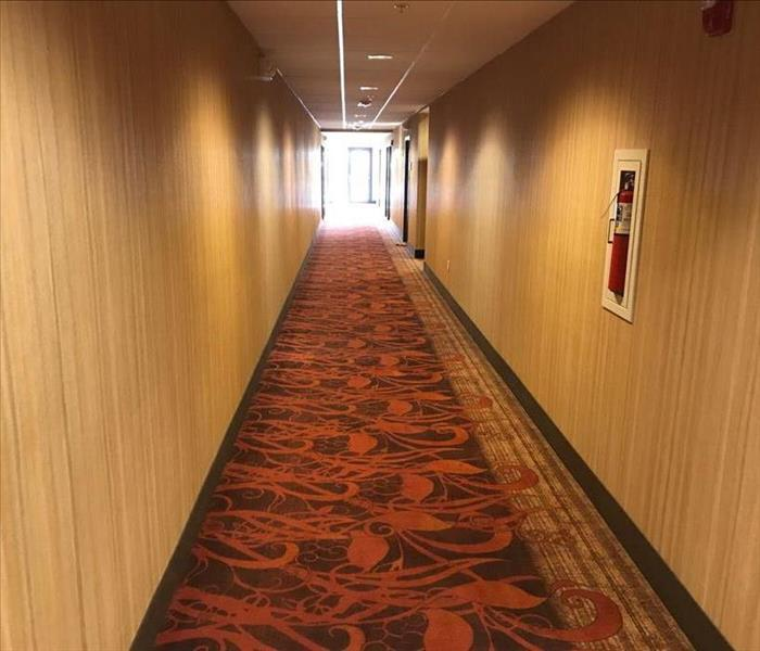 long hallway with geometric carpeting