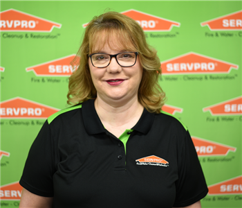 image of female sitting in front of SERVPRO backdrop