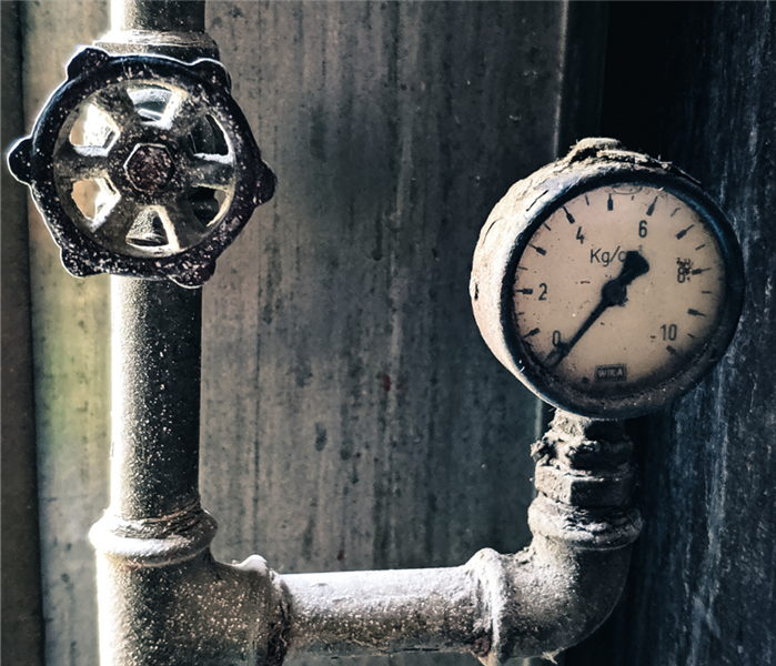 Picture is a of an outside frozen water pipe showing the temperature as 0 degrees.